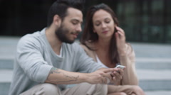 Young Positive Woman And Man are Using Mobile Phone Outdoors. Stock Footage