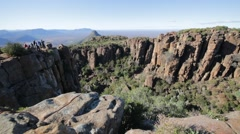 People  in south africa valley of desolation Stock Footage