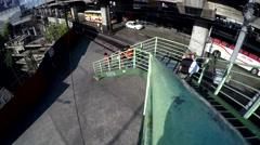 People go down on stair of elevated walkway Stock Footage