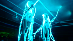Two girls on a beach party in neon lights Stock Footage