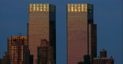 Two identical rectangular skyscrapers against a clear evening sky Stock Footage
