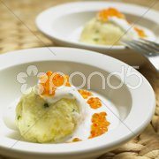 Cold potato dumplings with cream and caviar Stock Photos