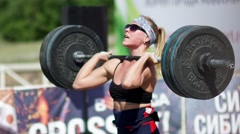 Russia, Novosibirsk, 2016: Female weightlifter raises the bar Stock Footage