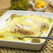 Salmon and endive baked with chedar sauce Stock Photos