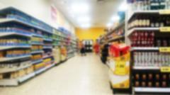 Shelves inside a supermarket. Out of focus. Stock Photos