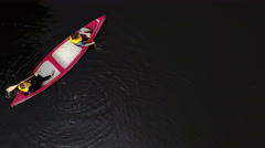 Aerial shot of the two people canoeing Stock Footage