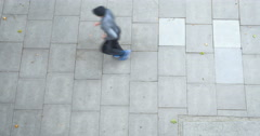 High view of jogger running along concrete pavement Stock Footage