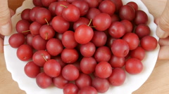 Cherry plum on the plate. Stock Footage