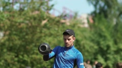 Russia, Novosibirsk, 2016: A man lifts the weight up. Slowmotion Stock Footage