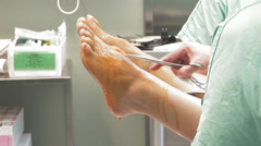 Surgical team disinfect patient's legs with iodine solution for a surgery Stock Footage