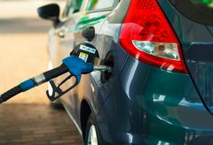 Car refueling on a petrol station close up Stock Photos