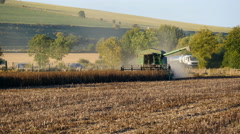 Long shot of combine harvester in field Stock Footage
