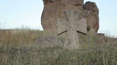 Old cross in a field Stock Footage
