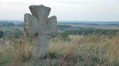 Old stone cross in cemetery Stock Footage
