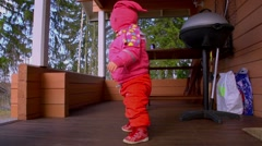 A little 1 year old girl is dancing Stock Footage