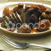 Boar rump in red wine Stock Photos