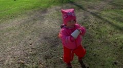 A little 1 year old girl is walking. Slow motion Stock Footage