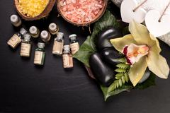 Spa concept with stones, flowers , essential oils and mineral salt Stock Photos