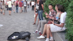 Street musicians play guitar Stock Footage