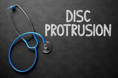 Disc Protrusion Handwritten on Chalkboard. 3D Illustration Stock Illustration