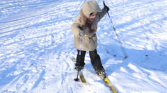 Two little kids learning to ski Stock Footage