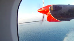 Small seaplane landing in the Maldives Stock Footage