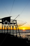 Pier with fishing net during sunrise, Gironde Department, Aquitaine, France Stock Photos