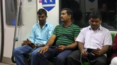 Indian Men Using Smartphones in Subway in City Stock Footage