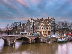 Canal houses sunset Amsterdam Stock Photos