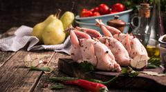 Fresh organic quails on vintage wooden table, healthy food Stock Photos