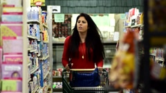 Woman / Girl in family grocery store shopping for food 2 Stock Footage
