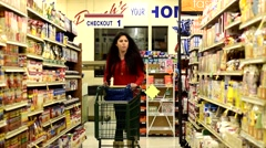 Woman / Girl in family grocery store shopping for food 4 Arkistovideo