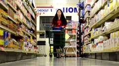 Woman / Girl in family grocery store shopping for food 5 Stock Footage