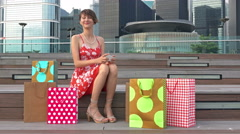 Happy pretty young woman with shopping bags makes photo self-portrait. Stock Footage