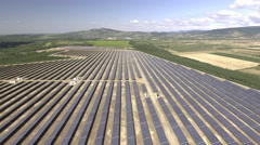 Aerial view of large solar panel farm field Stock Footage