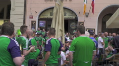 Irish fans throw massive sing-song in Old Town Square Prague's Pub Party Stock Footage