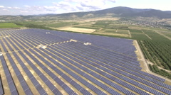 Aerial view of large solar panel farm Stock Footage