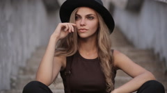 Happy young pretty girl in black hat Stock Footage
