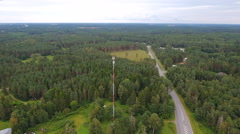 Aerial shot of the tall GSM tower in the forest Stock Footage