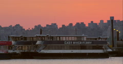 East River Ferry boats parked in marina with NYC skyline in background Stock Footage