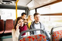 Group of young people traveling by bus, having fun Stock Photos