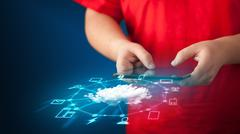 Close up of hand holding tablet with cloud network technology Stock Photos