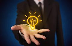 Sales guy has bright idea in the hand Stock Photos