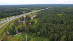 The tall tower of the GSM tower in the forest Stock Footage