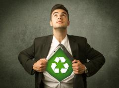 Enviromentalist business man tearing off shirt with recycle sign Stock Photos