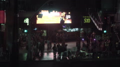 People crowded on Hollywood Boulevard at night with sign in LA Stock Footage