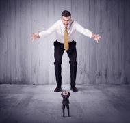 Huge boss lokking at small business man Stock Photos
