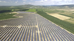 Aerial shot of large solar panel farm Stock Footage
