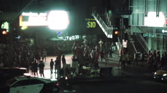 LAPD police car driving on Hollywood Boulevard at night in Los Angeles Stock Footage