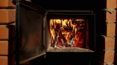 Russian bathhouse. Close-up shot of the flame in a furnace of the wood stove. HD Stock Footage